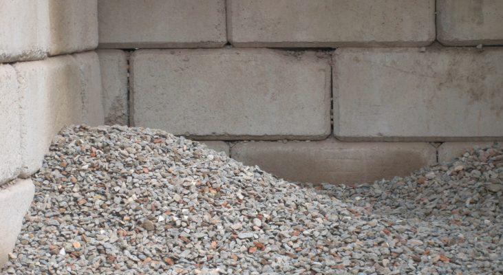 Concrete interlocking blocks displayed with concrete aggregate Minto